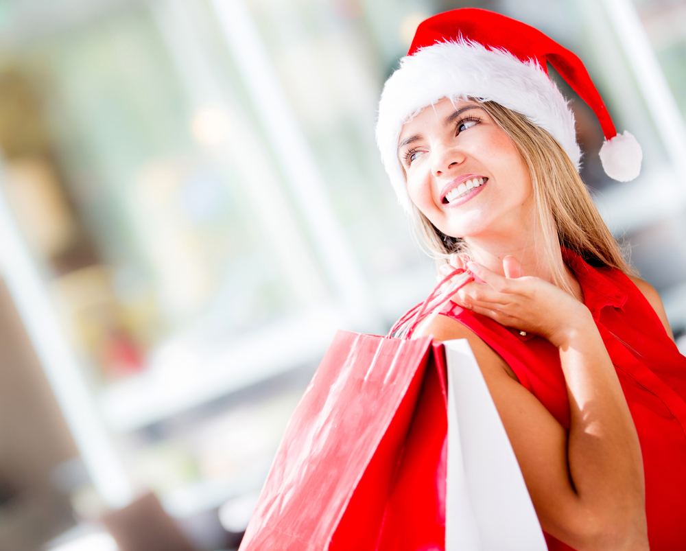 Beautiful happy woman doing her Christmas shopping