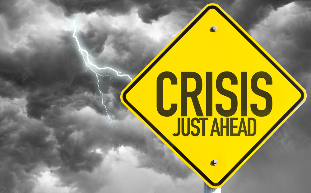 Crisis Just Ahead sign with a bad day
