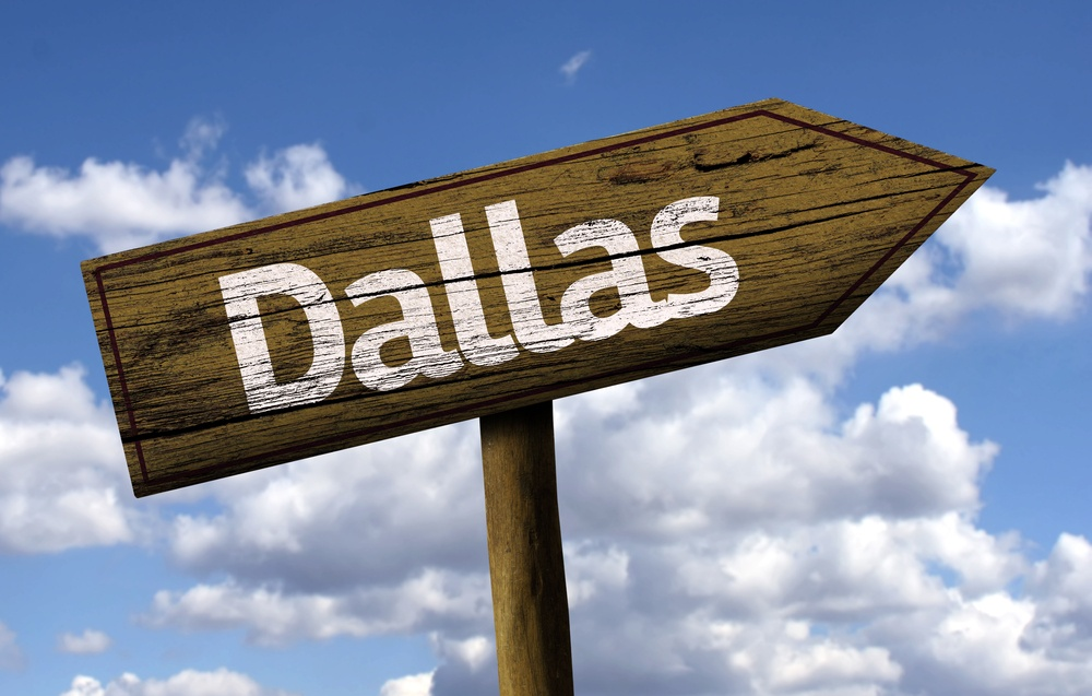 Dallas wooden sign on a beautiful day