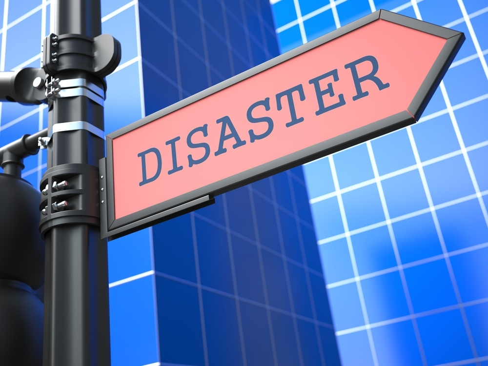 """Disaster Concept. """"Disaster"""" Red Roadsign Arrow on Blue Background."""