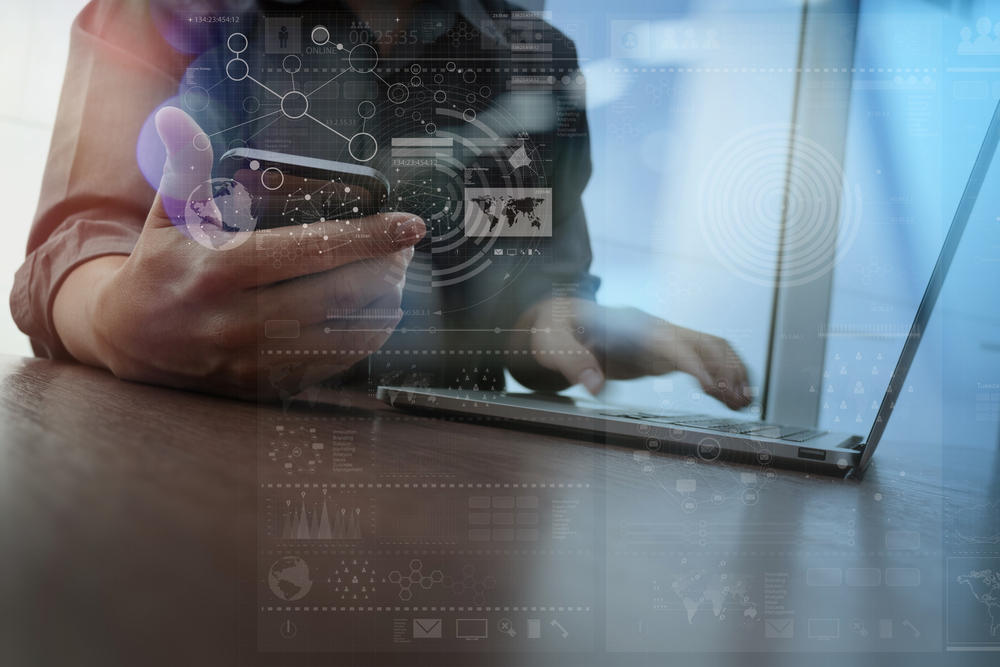 Double exposure of businessman hand working with mobile phone and modern computer and business strategy as concept