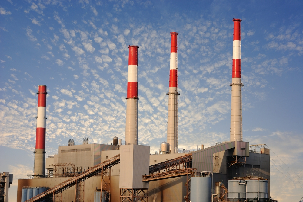 Factory against blue cloudy sky-1