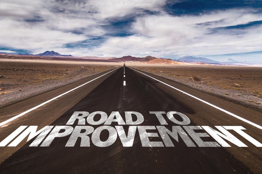 Road to Improvement written on desert road