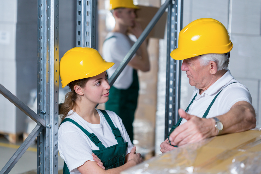 Storage workers during their work in warehouse