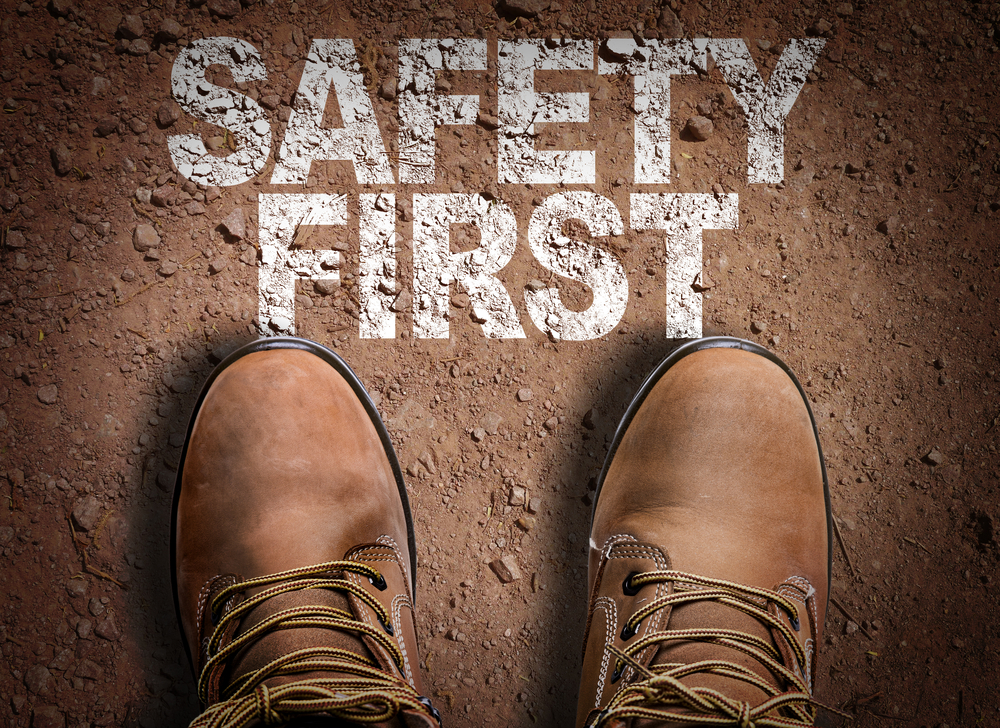 Top View of Boot on the trail with the text Safety First