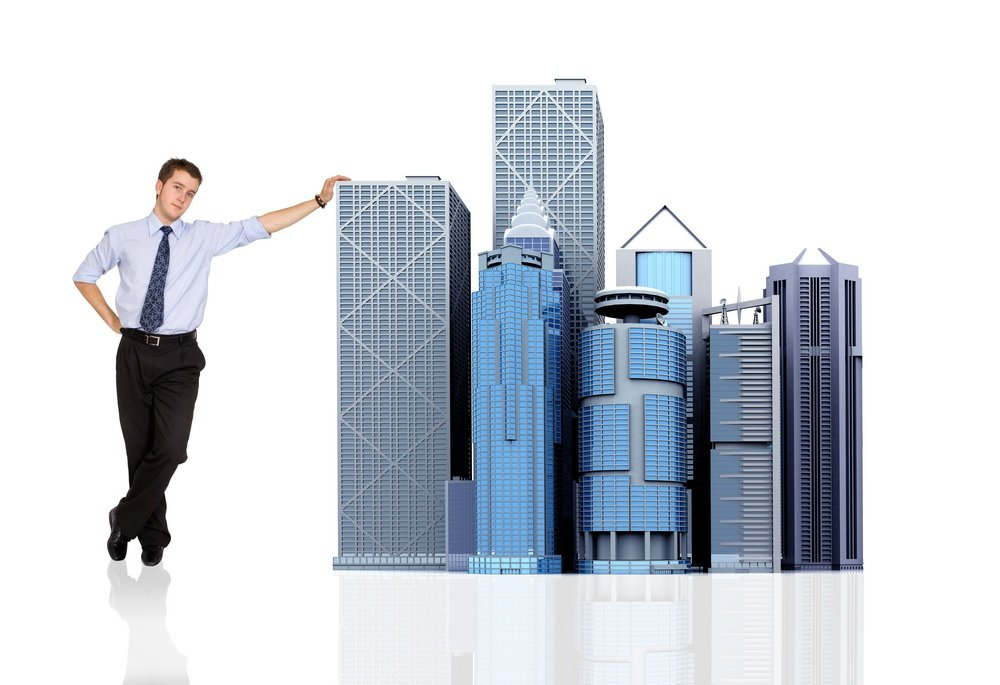 business man and his big corporation - buildings made in 3d - over white