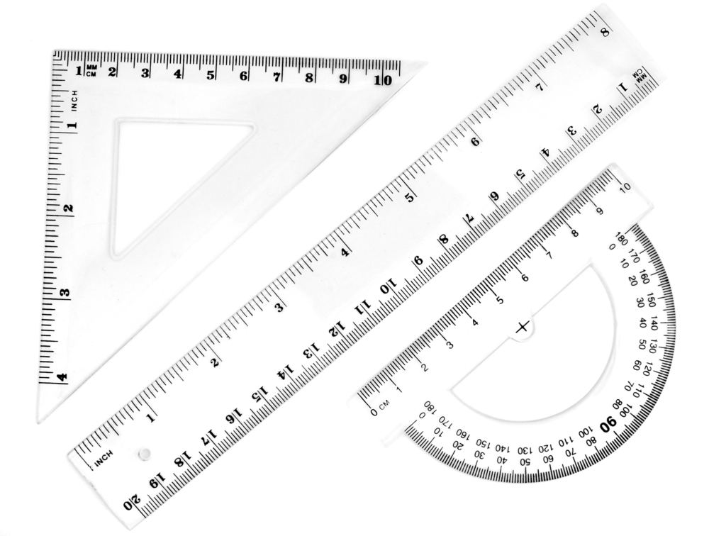close up of different rulers and  school supplies on white background with clipping path